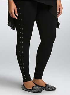 Leggings: we just can't live without them. Give your solid black pair a rock 'n roll makeover with this full-length style. Silver tone skulls stud the sides, giving a hint of gleam as you strut. Stretchy fabric and an elastic waistband add smooth definition.
