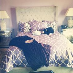 Reminds me of my room :) I like the pattern on the bed!