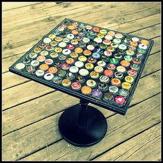 I think that tables like this look so cool!  This is why I am saving my bottle caps!