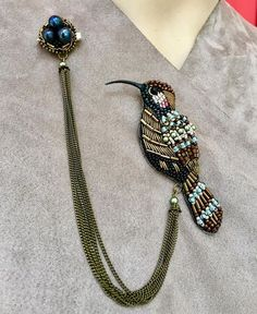 Gorgeous bird with sequins, beads & tasselNo photo description available. Bead Embroidery Jewelry, Fabric Jewelry, Beaded Embroidery, Hand Embroidery, Embroidery Designs, Bead Jewellery, Beaded Jewelry, Jewelery, Beaded Bracelets