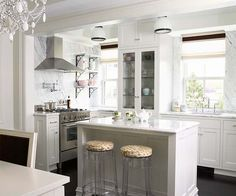 Classic small kitchen - love the windows and lack of upper cabinets which can weigh down a kitchen.  Very fresh & updated, yet totally timeless!  bhg.com
