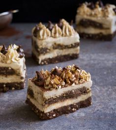 Raw tiramisu cheesecakes with a choc biscuit base, layers of fluffy vanilla cheesecake, a dehydrated choc biscuit dipped in coffee caramel and pretty stuff on top