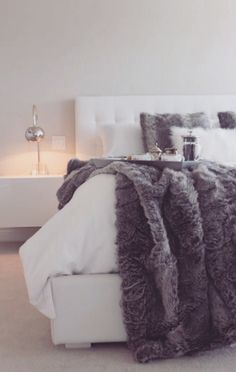 That bed looks so comfortable! And those furry blankets! #cozy