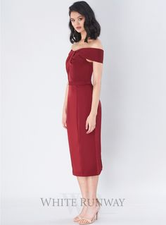 Avery Cocktail Dress. A gorgeous midi length dress by Jadore. An off shoulder style featuring crossover detailing on the bust and fitted pencil skirt with back split.