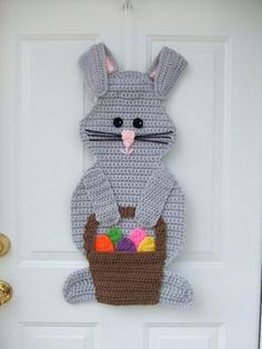 These 25 Easter crochet patterns including baskets, egg cozies, decor and wearables. They feature bunnies, chicks and other Easter favorites.: Bunny With Basket Door Hanging Crochet Pattern Crochet Bunny Pattern, Easter Crochet Patterns, Easter Projects, Easter Crafts, Easter Ideas, Crochet Cross, Free Crochet, Crochet Motif, Crochet Flowers