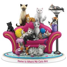 A FIRST! Limited-edition Blake Jensen figurine handcrafted and hand-painted, features a dozen cats from a variety of breeds lounging on the couch.