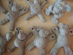 """Once upon an Art Room: Clay - Project 3 - Teddy Bears Two thick coils joined in an """"X"""". Add a ball belly and ball head. Pad of clay for the shout and eyes and ears. use a straw to poke hanging holes in the paws Teddy Bears Picnic! Clay Projects For Kids, Kids Clay, Third Grade Art, Grade 2, Clay Bear, Pottery Classes, Ceramics Projects, Art Lessons Elementary, Bear Art"""