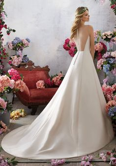 Designer Wedding Dresses and Bridal Gowns by Morilee. This Elegant A-Line Wedding Gown with an Illusion Net Back which is Accented with Covered Button Details.