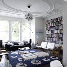 Classic, contemporary living room, with bold indigo and white features