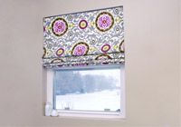 If you are looking for a way to spruce up your window treatments, try making pretty Roman shades using the mini blinds you already have! No sewing required!
