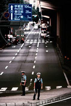 Cops on traffic duty in Ueno, Tokyo.