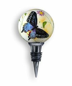 Wine Stopper, Butterfly Design, 5-Inches Tall by Ne'Qwa. $25.99. Features licensed art from leading gift industry artists. Each piece is individually hand painted from the inside by our skilled artisans. Butterfly Design by Noted Artist, Paul Brent. Each item is luxuriously housed in a velour and satin presentation case with protection in mind.  Makes a great item for your home or as a gift.. Mouth Blown Glass wine stopper, reverse hand-painted. This distincti...