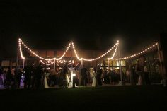 Beautiful specialty lighting outside for dancing during the reception.