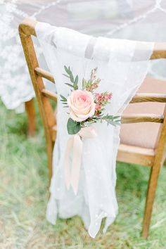 Decorate chairs w/sheer fabric & roses