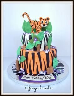 Tiger Cake Tiger is made from gumpaste. Design was originally made up by the birthday girl. She wanted a tiger, purple flowers and an...