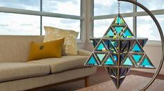New Moon stainless steel stand, large. Castor Geometrica sculpture, dichroic grey glass, medium size. Zakay Glass Creations