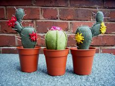 Felt cactus pincushions made by Felt Mistress / you could leave these out if you aren't done with your sewing project, they are cute enough!