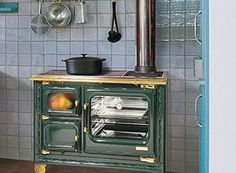 Tile entire wall behind wood cook stove, hang utensils?
