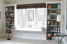 Living Room:Great Looking Bay Window Seat Design With Twin White Bookshelves And Drum Shape White Table Lamp Easy to Follow Window Seat Ideas to Inspire your Indoor Living