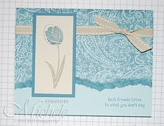 """Faux Tearing Tutorial. Cardstock: Soft Sky,  Natural Ivory, Blue Bayou.   16"""" piece of River Rock double stitched ribbon.   Stamps: Garden Whimsy, Paisley background.   Ink: Blue Bayou, Mellow Moss.   Brayer, Stampin' Dimensionals, Dauber, scrap paper, SNAIL adhesive."""