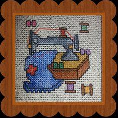 Una máquina de coser en punto de cruz/sewing machine, crossstitch .