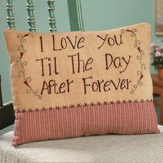 """I Love You..."" Pillow. Hand-stitched with a sweetheart's message, this love-proclaiming, stuffed cotton fabric pillow features heart-strewn vines on a mix of country fabric. Pillow reads, ""I love you til the day after forever"". This sentimental pillow makes a thoughtful gift for your beloved any day of the year. Imported. 10""H x 13""W."