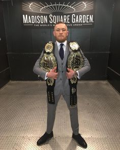 After defeating Eddie Alrarez via TKO, Conor McGregor is now the Lightweight Champ and the Featherweight of UFC. Conner Mcgregor, Mcgregor Fight, Conor Mcgregor Style, Ufc Boxing, Boxing Fight, Madison Square Garden, Ufc 205, Ufc Titles, Moda Masculina