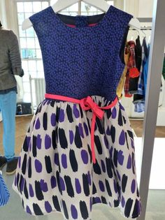 Mixed prints with a spotty top, neon belt and splash print skirt in this kids dress from M for fall 2013