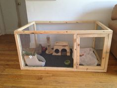 "This is the bunny cage my boyfriend and I made for my two baby holland lops. The bottom is a crate pan bought from the pet store. The cage is about 30"" x 24"" x 50"" and cost less than $100 to make."