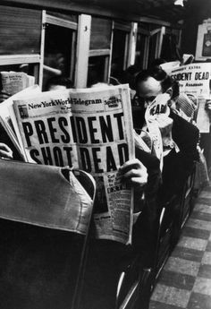 New York Commuters read of John F. Kennedy's assassination, November 1963.