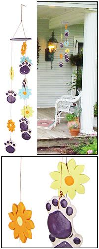 I love wind chimes : ), Flowers : ) & of course thoses cute paw prints! So I enough said....I want this  : )-  Purple Paw & Flowers Wind Chime at The Animal Rescue Site
