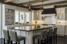 White wood kitchen with barn beams designed by Glenda Swanson of Geneva Cabinet Gallery