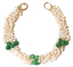 Helga Wagner, Six strands of fresh water pearls with three stations of apple green chrysoprase and tiffany clasp.