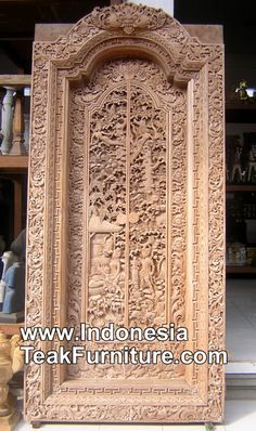 Handcarved door from Bali Indonesia with traditional carvings.
