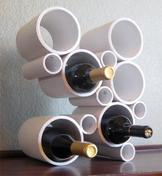 Amazing DIY Wine Storage Ideas made out of pvc pipes bought at any home improvement store. You could put chocolate bars in the smaller pipes! Pvc Pipe Projects, Craft Projects, Wine Bottle Holders, Bottle Rack, Wine Storage, Storage Rack, Wine Bottle Storage Ideas, Pvc Pipe Storage, Yarn Storage
