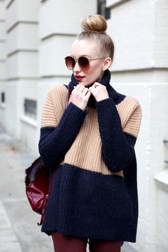 color block chunky sweater and top knot with cat eye glasses :) perfection
