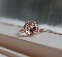 Obsessed with this Peach Champagne sapphire diamond ring