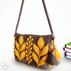 #crochetembossedbag #bohohippie #bohostyle #embossedcrochet #crochetarts #crochetleafbag #tapestrycrochet #uniquedesign #crochet #crochetbags #bagsandpurses #handmade #handmadebags #handmadebyme #bags #tote #totebag #bagsandpurses #onlinebags #crochetshoulderbag #crossbodybag #messengerbag #embossedleaf #3dleafbag #crochethandbag #handbags #beachbag #bohobag #sandbeige #yellowbag #purses #crochetlove #crochetlover #crochetaddict #simartshop Crochet Cable, Crochet Tote, Crochet Handbags, Crochet Granny, Cluch Bag, Butterfly Bags, Pineapple Crochet, Unique Bags, Red Bags