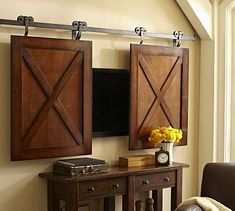 Rolling Cabinet Media Solution ..........Kind of like this for a wall mounted TV...........