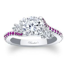 Simply elegant describes this pink sapphire and diamond engagement ring.  Featuring a prong set round diamond center graced on each side with a flare of marquise cut diamonds and accented with pink sapphires cascading down the dainty shank for a touch of sheer elegance.<br />  <br />  Also available in rose, yellow gold, 18k and Platinum.<br />