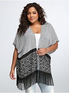 """<p>This kimono is a kimo-yes! A boho-inspired black and white print makes the easy, open shape a groovy addition to your wardrobe. A fringe hem adds movement to any ensemble (perfect for throwing on as you head out the door).</p>  <p></p>  <p><b>Model is 5'10"""", size 1</b></p>  <ul> <li>Size 1 measures 27 5/8"""" from center front</li> <li>Rayon</li> <li>Hand wash cold, dry flat</li> <li>Made in USA plus size kimono</li> </ul>"""
