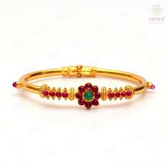 Anvi's kempu kada studded with rubies and emeralds in floral design