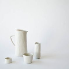 """A textured stoneware collection with glazed interior and raw exterior. Pitcher: 3.5""""D x 8.75""""HSmall Pitcher: 2""""D x 5""""HSmall Tumbler: 3""""D x 2.5"""" HMini Cellar:..."""
