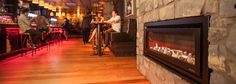 Escea DL1100 gas fire in a popular bar featured in a stone wall.