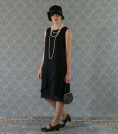 This black flapper dress is really chic and stylish! The whole dress is made of beautiful black chiffon fabric which is very soft to the touch. We love the skirt detail of the ruffled part which goes from one side of the dress all the way from the front, around the back and meets again on the same side. A small rolled hem is used for this ruffled part so that it will flow and drape freely. The front of the bodice has lovely V shape seams adding nice details to the streamlined design of the…