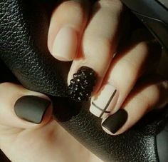 Nude and black Matt nails with cross