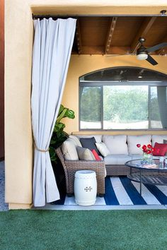 This gorgeous covered patio includes outdoor curtains, string lights an industrial ceiling fan and the Tobago outdoor seating set. It's just a small part of a total backyard makeover by Caitlin Ketcham of Desert Domicile. See all of this amazing low maint Outdoor Curtains For Patio, Porch Curtains, Outdoor Decor, Outdoor Seating, Building A Floating Deck, Low Maintenance Backyard, Pergola Diy, Cheap Pergola, Backyard Makeover
