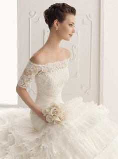 Wow! The top half of this dress is STUNNING! Alma Novia lace wedding dresses 2012