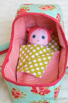 """Sweet little homemade doll bassinet. Love the soft flannel inside with the floral cotton on the outside. Complete with blanket and pillow for your favorite doll. Pattern from """"Dana Made It""""."""