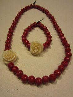 ketting en armband met kralen en roosje